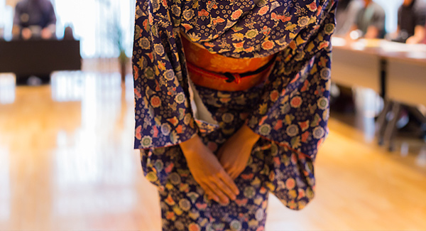 travel with home exchange woman in kimono bowing