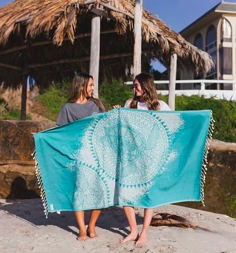 Sand Cloud beach towel- HomeExchange beach essentials