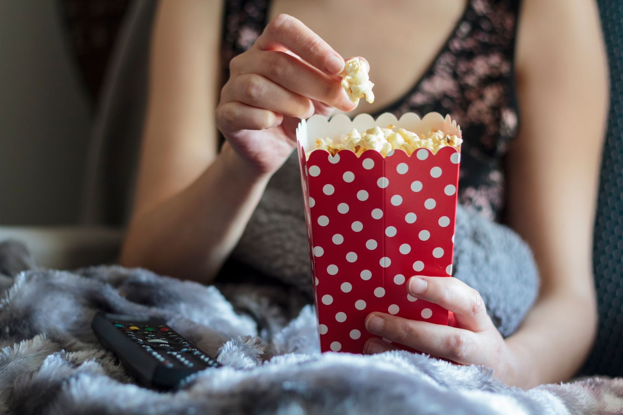 Woman eating popcorn - HomeExchange chain story