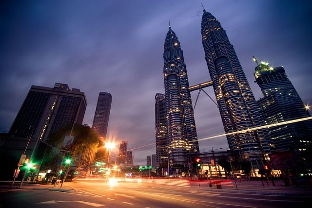 GuestToGuest, home exchange, sharing economy, beautiful places at night, petronas towers kuala lumpar